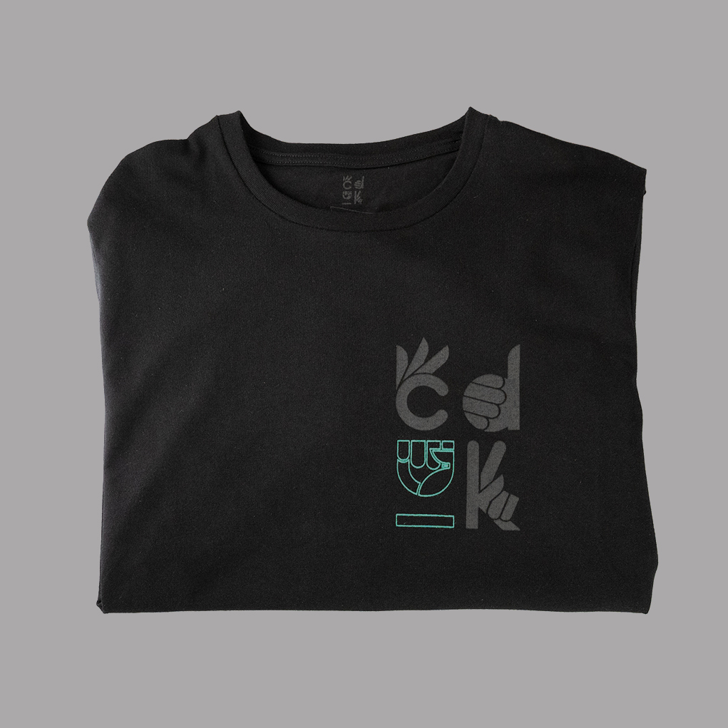 product shot of the front of a black unisex t-shirt with CDUK's logo made from sustainable organic cotton and produced ethically by refugess paying a living wage.